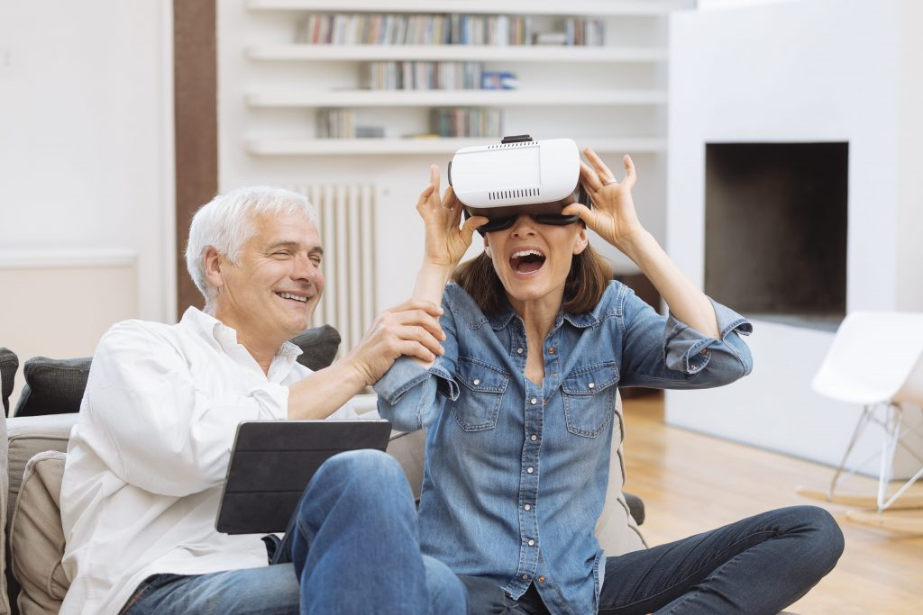 Mature couple with augmented reality